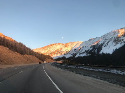 Moonrise over the mountains as I drive into Boulder